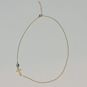Gold color Sideways cross with evil eye necklace